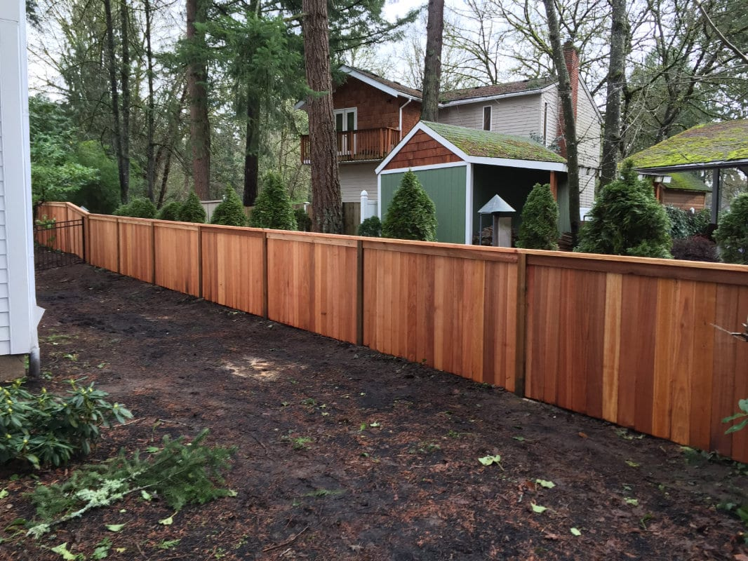 privacy fence with top rail